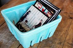 Nifty way to display iphone photos on a coffee table in this ceramic basket from #anthropologie.