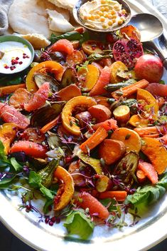 ROAST VEGETABLES WITH TAHINI AND YOGHURT DRIZZLE