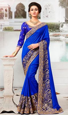 Style yourself with delicacy stepping out in this blue color embroidered bhagalpuri silk sari. You could see some fascinating patterns accomplished with lace, bead, resham and stones work. #stylishsaree #royalbluesari #embroideredsaris