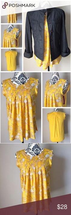 """NWT Merona gold yellow white floral sleeveless top NWT Merona golden yellow, white, and brown floral sleeveless top with solid jersey knit back. Front flowy material is 100% polyester and back is 96% rayon / 4% spandex for a smooth, lightweight, comfortable feel. Armpit to armpit approximately 17"""", arm openings 9"""", length from top of shoulder to hem is 22"""". Never worn or washed. 👜 Looks adorable with army green chinos, J. Jill XSP chambray jacket (available in my closet), ballet flats, and…"""