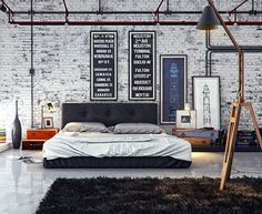 Modern industrial loft bedroom: love the signs hung above the bed.