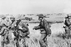 Heavily armed Das Reich Division panzergrenadiers prior to mounting up on their SdKfz 251 halftracks for a combined tank and infantry attack. Pinned from germanwarmachine.com