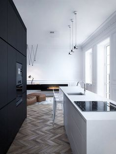Black and white balance by the warmth of wood and leather in natural tones.