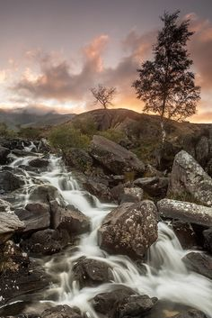 Pastel colours light up the sky as the sun sets behind the waterfall of Rhaeadr Idwal, near Lly Ogwen in Snowdonia National Park. Pastel Colors, Light Colors, Colours, Smart Image, Snowdonia National Park, Light Up, Waterfall, National Parks, Sky