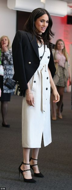 The belted summer number was a departure from the black wide-legged trousers Meghan normally favours