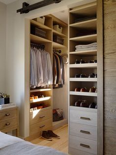 Barn style door for closet with built-in storage solution.