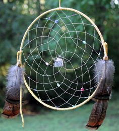 """Dream Home Dream Catcher - Find the home of your dreams with this 14"""" dream catcher wrapped in soft tan leather adorned with multi-colored glass beads, turkey feathers and a dream house pendent that opens up to reveal the interior of the house."""