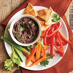 Delicious black bean hummus! Also includes simple instructions for making your own pita chips that aren't covered in grease or oil from the fryer, but suggests cut veggies as a dipper, too!