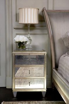 A mirrored nightstand adds just enough glamour in a basic way.