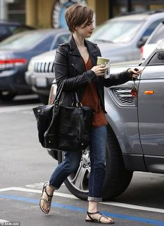 Lily Collins displays her new pixie crop as she picks up a healthy green juice the morning after the Vanity Fair Oscars party