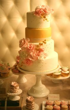 Pink and gold wedding cake By Francisca from Cupcake- minus the yellow layer- maybe gold trim on the bottom instead