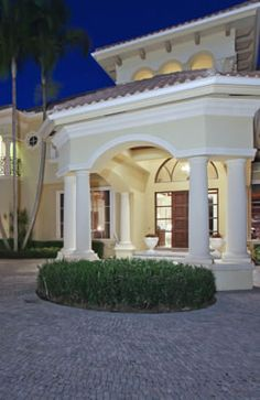 Here is a look at the grand style entrances you can find with a Ballenisle's home! http://www.waterfront-properties.com/pbgballenisles.php