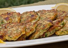 The word fritter usually conjures up something heavy and deep-fried, but these zucchini pancakes are as light and delicate as can be. Shredded zucchini is combined with eggs, garlic, scallions, feta and dill, and then pan-fried in olive oil until crisp on the exterior and tender on the interior. I like them best as a light vegetarian meal or mezze