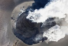 Volcanic lightning or a dirty thunderstorm is seen above Shinmoedake peak as it erupts, between Miyazaki and Kagoshima prefectures, Japan, in this photo taken from Kirishima city.REUTERS. #Volcano #Nature