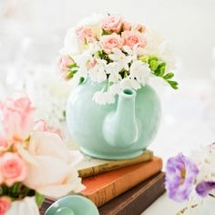 Teapots would be cute in your vintage wedding decor.   A wedding in the basement of a London bookstore with rustic floral teapots and some lovely DIY inspirational ideas.