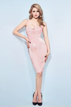 """<div>Cut to perfection and exquisitely refined, the Lingerie Corset Dress is an elegant cocktail hour essential in frosty baby pink. Delicately crafted from a selection of luxury satin and lace fabrics paneled with Carmen lace, ribbons, lush satin and mesh to emulate an understated vintage 50s """"négligée"""" aesthetic. This limited edition piece features the signature Wheels"""