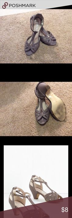 "Modcloth Architectural Tour T strap heel Made by Chelsea Crew, sold by Modcloth. Warm stone grey, or ""cement"" in Color, almost taupey grey T Straps, slightly worn sole (see photo), I wear size 7 and these fit me perfectly. Dings/superficial tear from wear on back/heel (see photo). Photo with white background is new shoe, photos on rug are shoes now. Worn but very wearable, structurally sound with wear n tear marks. ModCloth Shoes Heels"