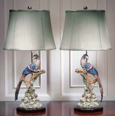 "Brilliant reproductions from the Williamsburg Restoration collection by Mottahedeh. Each lamp is expertly handcrafted of the finest porcelain with emphasis on color. Silk shades come fitted with decorative finial; bases have been created to compliment the design in hand-finished hardwood. UL approved. 32""h."