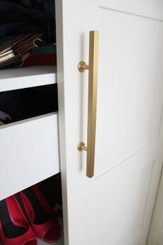 wardrobe handles - brass square finish on white