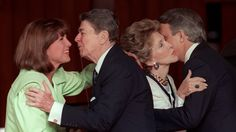 Mila Mulroney (left) gets a kiss from then U.S. President Ronald Reagan as his wife Nancy gets a kiss from Prime Minister Brian Mulroney (right) at the official welcoming ceremony for the economic summit in Toronto June 19, 1988.