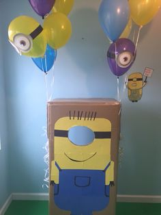 Minion photo booth with balloons attached.