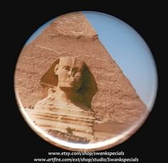 This button (or magnet) shows the head and shoulders of the Sphinx and part of the Great Pyramid.    We made this with a professional press, using the highest quality materials. It measures 2.25 inches. To obtain magnets for conversion of 2.25 inch pinback buttons to magnets go to http://www.artfire.com/ext/shop/stats/10379675 See our shops at www.etsy.com/shop/swankspecials  and www.etsy.com/shop/kohaku16