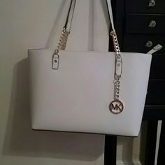 BNWT.  MK Jet Set Chain Tote 100% authentic.  Comes with tags and care booklet.  Perfect white for spring and summer. Michael Kors Bags Shoulder Bags
