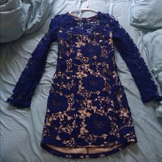 Navy blue lace dress Gorgeous navy blue lace dress. The pattern is flowers for the lace. I've never worn it, I don't like how it fits on me but it is gorgeous. Charlotte Russe Dresses Long Sleeve