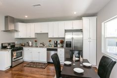 Great kitchen has new granite counters, white cabinetry, all new stainless steel appliances. Dining/kitchen area is relatively close together, yet doesn't feel cramped. The shiny hardwood floors are gorgeous! #RealEstate #HomeFlipping #California #House  www.verono.com/nassau