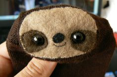 A cute sloth made out of a pair of socks!