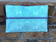 Small Aqua/Grey Zippered bag with front mesh pocket 8x13. Wipeable/water resistant lining.