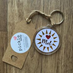 A personal favourite from my Etsy shop https://www.etsy.com/uk/listing/399929159/personalised-sun-heart-papercut-keyring