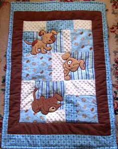 "Puppy baby blanket / quilt with minky flannel front and patchwork coordinating flannel back.   It is very cozy and soft with a high loft batting inside that gives the Blanket a 3D effect with a very soft cozy feel  This is a great blanket for ""tummy time"" and to travel anywhere with.    I have a coordinating blanket made of microfiber fleece front and minky  back,and can make a coordinating Crib sheet if you like..... message me with interest.   35 x 46  This may take 2 weeks to ship because…"