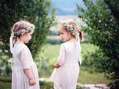 Bohemian #flowergirl friends clad in baby's breath wreaths and 3/4-sleeve shifts. For more flower girl tips, tricks, inspiration & ideas, visit us at www.flowergirlworld.com!