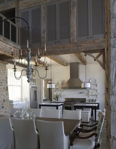Lake house kitchen by Tracery - beautiful shutters to give privacy to the loft when desired.