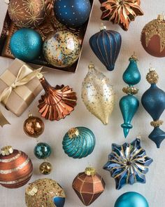 Our hand-painted Georgetown Ornament Set combines matte and metallic finishes to create a striking ensemble. Teal Christmas Tree, Christmas Tree Decorations Sets, Turquoise Christmas, Christmas Ornament Sets, Christmas Baubles, Christmas Colors, White Christmas, Christmas Mantels, Christmas Villages