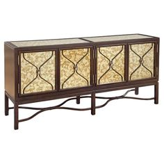 Perfect for stowing dinnerware and linens or displaying an extravagant spread of desserts, this wood sideboard showcases mercury glass paneling and a latticework overlay. Accent Furniture, Dining Room Furniture, Home Furniture, Metallic Furniture, Wooden Furniture, Dining Rooms, Office Furniture, Wood Sideboard