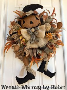 XL Halloween Primitive Scarecrow Jack-O-Lantern Wreath. This rustic looking fall creation is simple and fun! The primitive looking pumpkin character looks part scarecrow & part witch; I cant decide. But he sure is adorable and I think this look could go beyond Halloween thru Thanksgiving. The wreath is constructed with matte black deco mesh and is layered with ruffles of cinnamon brown metallic mesh and a frayed burlap mesh. The fantastic pumpkin parts are hand made by a very talented s...