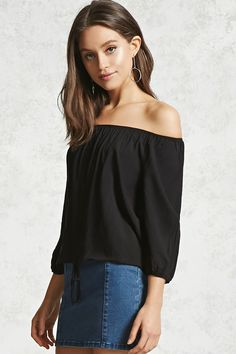 A woven top featuring an elasticized off-the-shoulder neckline, a button-down front, 3/4 length sleeves with elasticized cuffs, and an elasticized drawstring waist.