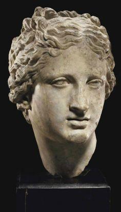A ROMAN MARBLE HEAD OF VENUS   CIRCA 1ST-2ND CENTURY A.D.