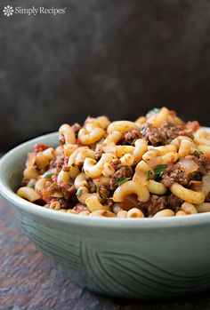 Hamburger and Macaroni ~ American comfort classic hamburger and macaroni recipe.  Browned ground beef cooked in a tomato onion sauce, mixed in with elbow macaroni. ~ SimplyRecipes.com