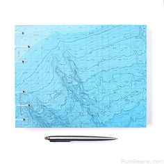 If this blue nautical chart reminds you of a topographic map, you'd be right! A bathymetric chart is the submerged equivalent of an above-water topographic map, so you can see all of the normally hidden twists and turns, hills and valleys that lie under the ocean!