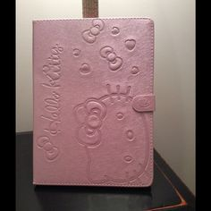 Hello Kitty Leather iPad Case In Pink Brand new, 3 adjustable stand options, magnetic close. Very pretty✨ For iPad Air 2 Price firm. No trades. Hello Kitty Accessories Tablet Cases