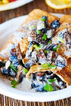 Crepes with creamy chicken and mushroom filling