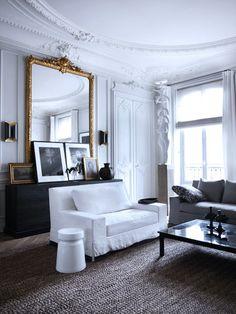 Paris Apartment // crown molding, gold gilded mirror, white sofa and textured rug #homedecor #interiordesign