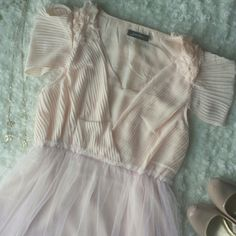 """Feminine and sweet pale peach dress So darling.  Perfect for date night, wedding season. Necklace not included.  Great condition. 33.5"""" length. Tulle skirt makes this very current.  You will need a slip under this.  14"""" elastic waist and then stretches from there. Janet Paris Dresses"""