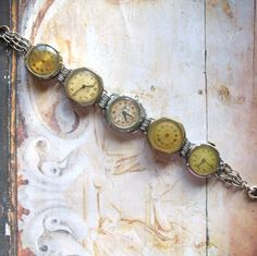 Great Watch faces in this Time After Time  Vintage Watch Assemblage Bracelet by ComeDayGoDay on ETSY