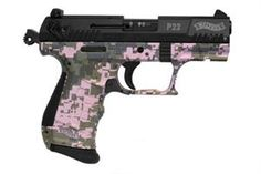 Not a big fan of pink guns, only because they look like toys and it's hard to tell if it's real or not... but here's another pink digi camo p22 walther with interchangeable grip panels.  ENJOY!