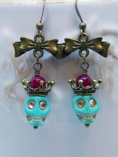 These Fun Skull Earring will be the hit of the party. Wear them with your favorite jeans and sweater for the festivities to begin! Rhinestones eyes add some extra bling to ... #boho_earrings #day_of_the_dead #earrings #funky_earrings #garnet_gemstones #goth_jewelry #halloween_earrings #jewelry #magnesite_skulls #skull_earrings #skull_jewelry #sugar_skull_earrings #turquoise_skulls #victorian_earrings #victorian_era_skull