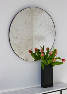 "Delightful hand crafted antiqued silver round mirror with an elegant bronze patina brass frame.  Ideal above a console table in the hallway, above a beautiful fireplace, in the bedroom or in the bathroom.  Design tip: looks stunning used as a cluster in different sizes and/or colours.  Framed mirror available in 20cm/7.9"", 40cm/15.8"", 50cm/19.7"", 60cm/23.6"", 79cm/31.1"" & 100cm/18.55"" (depth 18mm)."